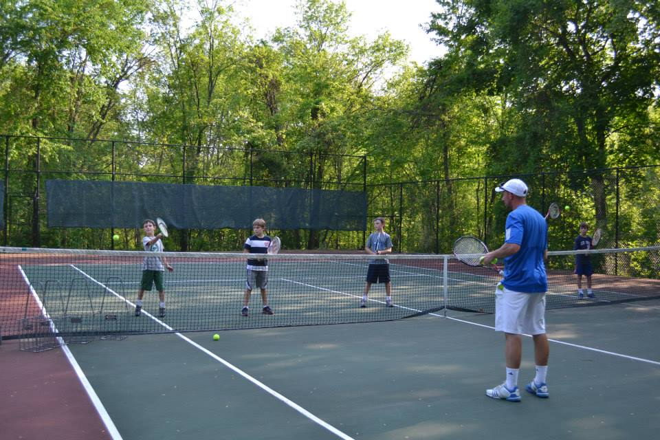 tennis pro teaching children