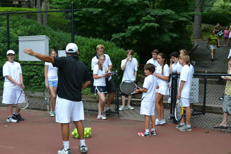 junior tennis players at practice